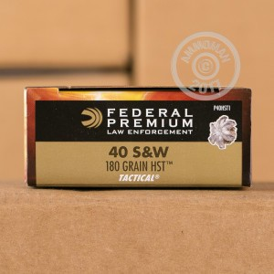 A photograph detailing the .40 Smith & Wesson ammo with JHP bullets made by Federal.