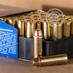A photograph of 50 rounds of 240 grain 44 Remington Magnum ammo with a FMJ bullet for sale.