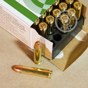 A photograph detailing the .30 Carbine ammo with metal case bullets made by Remington.