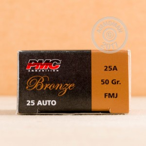 A photograph detailing the .25 ACP ammo with FMJ bullets made by PMC.