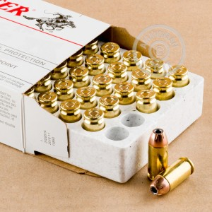 A photograph detailing the .40 Smith & Wesson ammo with JHP bullets made by Winchester.