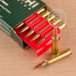 A photograph of 200 rounds of 77 grain 223 Remington ammo with a Hollow-Point Boat Tail (HP-BT) bullet for sale.