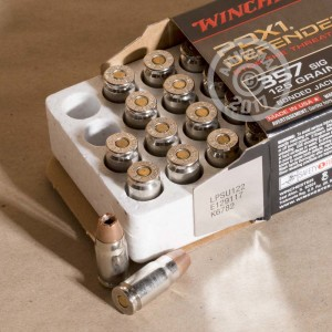 A photograph of 20 rounds of 125 grain 357 SIG ammo with a JHP bullet for sale.