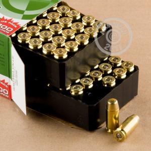 A photograph detailing the .40 Smith & Wesson ammo with FMJ bullets made by Remington.
