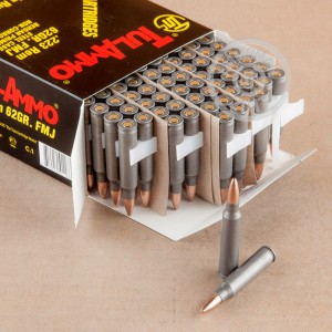 A photograph of 100 rounds of 62 grain 223 Remington ammo with a FMJ bullet for sale.