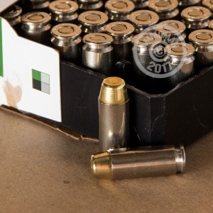 A photograph detailing the 10mm ammo with FMJ bullets made by Remington.
