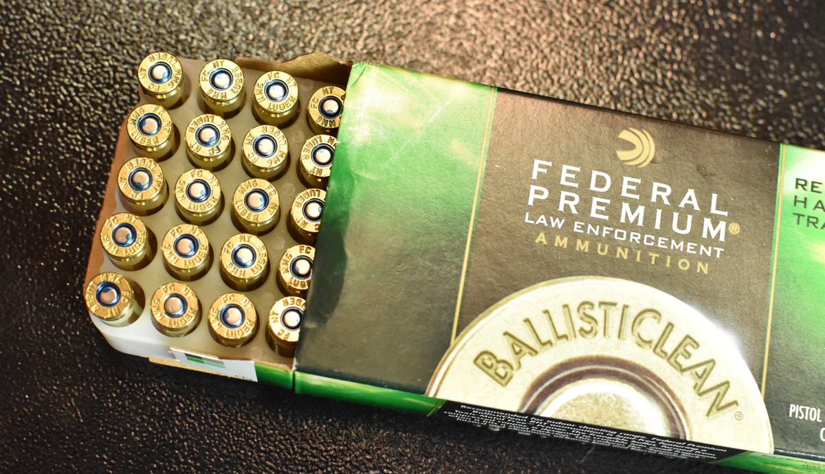 Brass cased 9x19 ammo on a table
