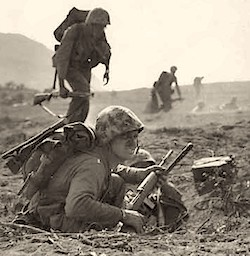 Marine carrying an M1 rifle chambered for 30 carbine ammo