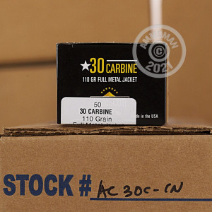 A photograph of 50 rounds of 110 grain .30 Carbine ammo with a FMJ bullet for sale.