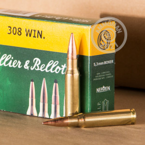A photograph of 20 rounds of 180 grain 308 / 7.62x51 ammo with a FMJ bullet for sale.