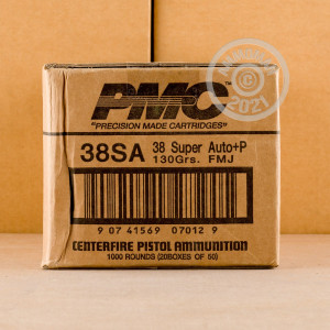 A photograph detailing the 38 Super ammo with FMJ bullets made by PMC.
