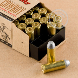 A photograph detailing the .45 COLT ammo with Lead Flat Nose bullets made by Hornady.