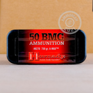 A photograph of 10 rounds of 750 grain .50 BMG ammo with a A-MAX MATCH bullet for sale.