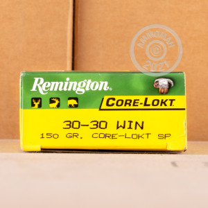 A photograph detailing the 30-30 Winchester ammo with CORE-LOKT soft point bullets made by Remington.