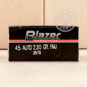 A photograph detailing the .45 Automatic ammo with FMJ bullets made by Blazer.