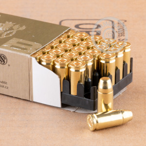A photograph of 50 rounds of 140 grain 9mm Luger ammo with a FMJ bullet for sale.