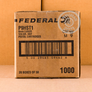 A photograph of 50 rounds of 124 grain 9mm Luger ammo with a JHP bullet for sale.