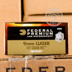 A photograph of 50 rounds of 147 grain 9mm Luger ammo with a JHP bullet for sale.