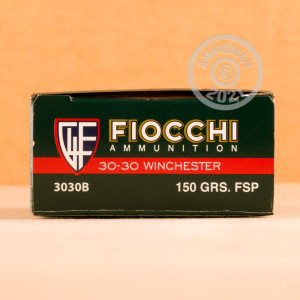 A photograph detailing the 30-30 Winchester ammo with flat soft point bullets made by Fiocchi.