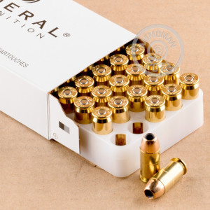 A photograph detailing the .45 Automatic ammo with JHP bullets made by Federal.