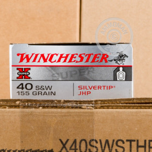 Photo of .40 Smith & Wesson JHP ammo by Winchester for sale at AmmoMan.com.