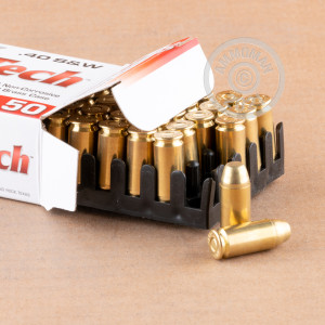 A photograph detailing the .40 Smith & Wesson ammo with FMJ bullets made by MaxxTech.