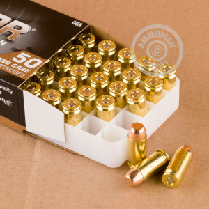 A photograph detailing the .40 Smith & Wesson ammo with FMJ bullets made by Blazer Brass.