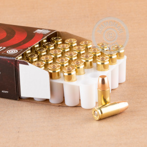 A photograph of 1000 rounds of 147 grain 9mm Luger ammo with a full metal jacket flat-point bullet for sale.