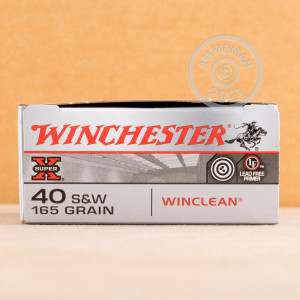 A photograph of 500 rounds of 165 grain .40 Smith & Wesson ammo with a brass enclosed base bullet for sale.