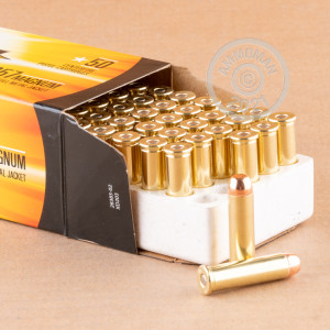 A photograph of 50 rounds of 158 grain 357 Magnum ammo with a FMJ bullet for sale.