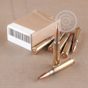 Image detailing the brass case and berdan primers on 15 rounds of Yugoslavian Surplus ammunition.