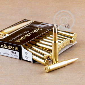 A photograph of 20 rounds of 196 grain 8mm Mauser JS ammo with a FMJ bullet for sale.