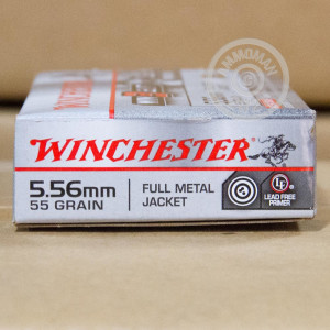 Photo detailing the 5.56 NATO WINCHESTER WIN3GUN 55 GRAIN FMJ (20 ROUNDS) for sale at AmmoMan.com.