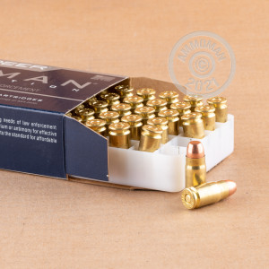 A photograph of 50 rounds of 125 grain 357 SIG ammo with a TMJ bullet for sale.