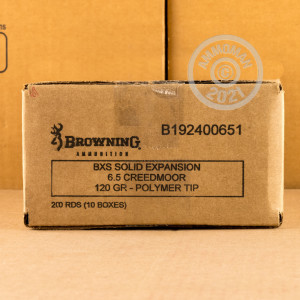 A photograph of 20 rounds of 120 grain 6.5MM CREEDMOOR ammo with a Solid Copper bullet for sale.