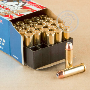 A photograph of 25 rounds of 125 grain 38 Special ammo with a JHP bullet for sale.