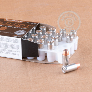 A photograph detailing the .32 ACP ammo with JHP bullets made by Speer.