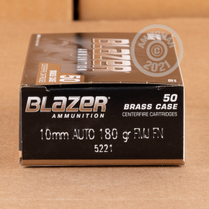 A photograph detailing the 10mm ammo with FMJ bullets made by Blazer Brass.