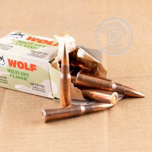 A photograph of 500 rounds of 148 grain 7.62 x 54R ammo with a FMJ bullet for sale.
