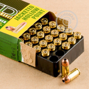 A photograph detailing the .380 Auto ammo with JHP bullets made by Remington.