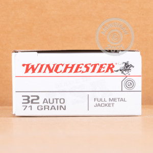 A photograph detailing the .32 ACP ammo with FMJ bullets made by Winchester.