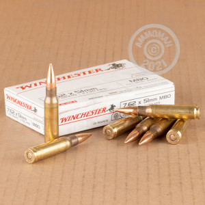 A photograph detailing the 308 / 7.62x51 ammo with FMJ bullets made by Winchester.
