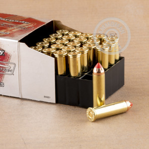 A photograph detailing the 357 Magnum ammo with JHP bullets made by Hornady.