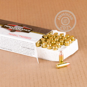 A photograph detailing the 38 Super ammo with FMJ bullets made by Corbon.