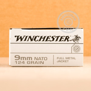 A photograph of 50 rounds of 124 grain 9mm Luger ammo with a FMJ bullet for sale.