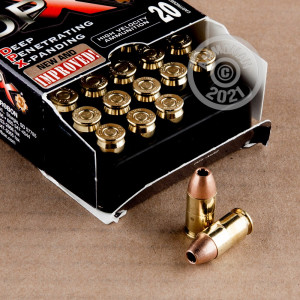 A photograph detailing the .380 Auto ammo with JHP bullets made by Corbon.