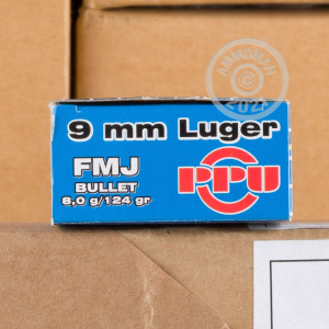 A photograph of 1000 rounds of 124 grain 9mm Luger ammo with a FMJ bullet for sale.