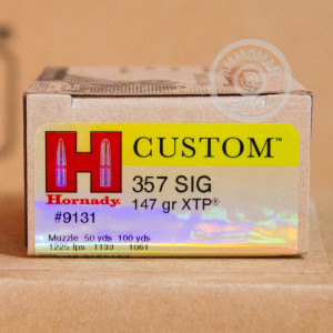 A photograph of 20 rounds of 147 grain 357 SIG ammo with a JHP bullet for sale.