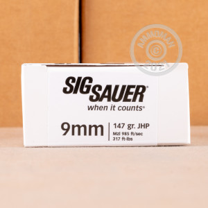 A photo of a box of SIG ammo in 9mm Luger.