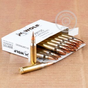 Photo detailing the 5.56X45 WOLF GOLD 55 GRAIN FMJ (1000 ROUNDS) (BRASS CASE) for sale at AmmoMan.com.